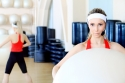 bigstock_young_sporty_woman_in_the_gym_13159400