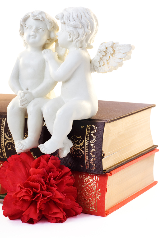 bigstock_figurine_of_two_angels_sitting_29986355